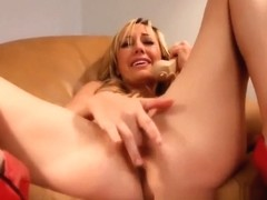 Brett Rossi fingers her hole and moans during phone sex
