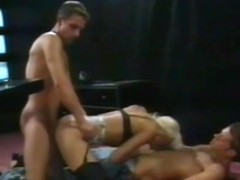 horny blonde giving to two guys