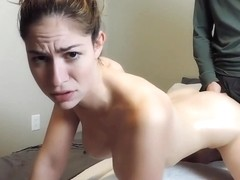 A kinky brunette enjoys a cum facial