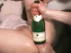 Big bottle up the slutty wet shaven cunt
