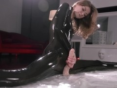 Maria wearing a latex strap on in solo