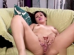 Mature Lisa smith using a toy to make a mess on the couch