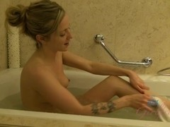 ATKGirlfriends video: Karla gets naked and hops into the tub to get cleaned up