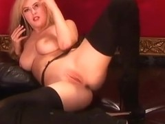 knockout blonde teasing in her boots