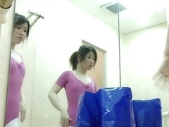 Cute Asian babe getting ready for ballet lessons