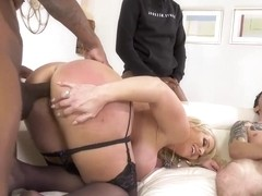 Gorgeous blonde milf with ample breasts is getting stuffed with two black cocks, at the same time