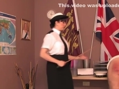 Police dominatrix paddles colleague over desk