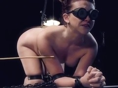 Brunette Mandy Muse is acting in bondage porn scene