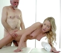 Frisky blonde is going an extra mile and fucking her elderly client instead of doing a massage